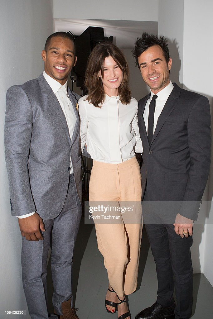 Victor Cruz, Hanneli Mustaparta and Justin Theroux pose backstage prior to the Calvin Klein Collection show as part of Milan Fashion Week Menswear Autumn/Winter 2013 on January 13, 2012 in Milan, Italy.