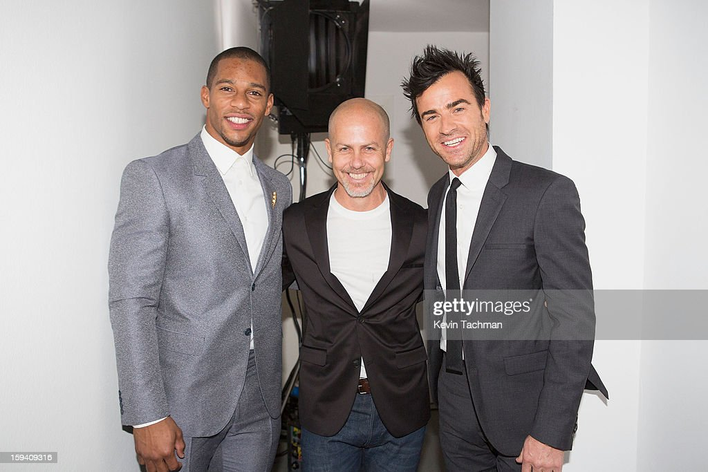 Victor Cruz, Men's Creative Director of Calvin Klein Collection <a gi-track='captionPersonalityLinkClicked' href=/galleries/search?phrase=Italo+Zucchelli&family=editorial&specificpeople=571545 ng-click='$event.stopPropagation()'>Italo Zucchelli</a> and <a gi-track='captionPersonalityLinkClicked' href=/galleries/search?phrase=Justin+Theroux&family=editorial&specificpeople=240634 ng-click='$event.stopPropagation()'>Justin Theroux</a> pose backstage prior to the Calvin Klein Collection show as part of Milan Fashion Week Menswear Autumn/Winter 2013 on January 13, 2013 in Milan, Italy.