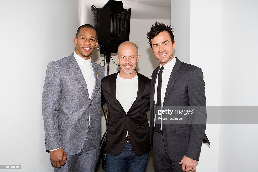 Victor Cruz, Men's Creative Director of Calvin Klein Collection Italo Zucchelli and Justin Theroux pose backstage prior to the Calvin Klein Collection show as part of Milan Fashion Week Menswear Autumn/Winter 2013 on January 13, 2013 in Milan, Italy.