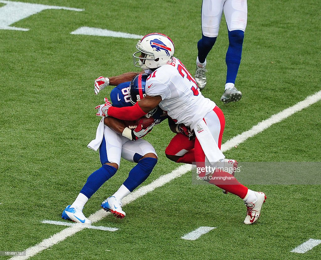 Victor Cruz #80 of the New York Giants and the NFC runs with a catch against Jairus Byrd #31 of the American Football Conference team during the 2013 Pro Bowl at Aloha Stadium on January 27, 2013 in Honolulu, Hawaii