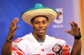 Victor Cruz of the New York Giants answers question from the media during Media Day ahead of Super Bowl XLVI against the New England Patriots at...