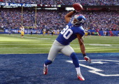 Victor Cruz of the New York Giants celebrates after he scored the game winning touchdown in the fourth quarter against the Washington Redskins on...