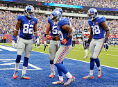 Victor Cruz of the New York Giants celebrates his touchdown with a dance against the Houston Texans in the second quarter at MetLife Stadium on...