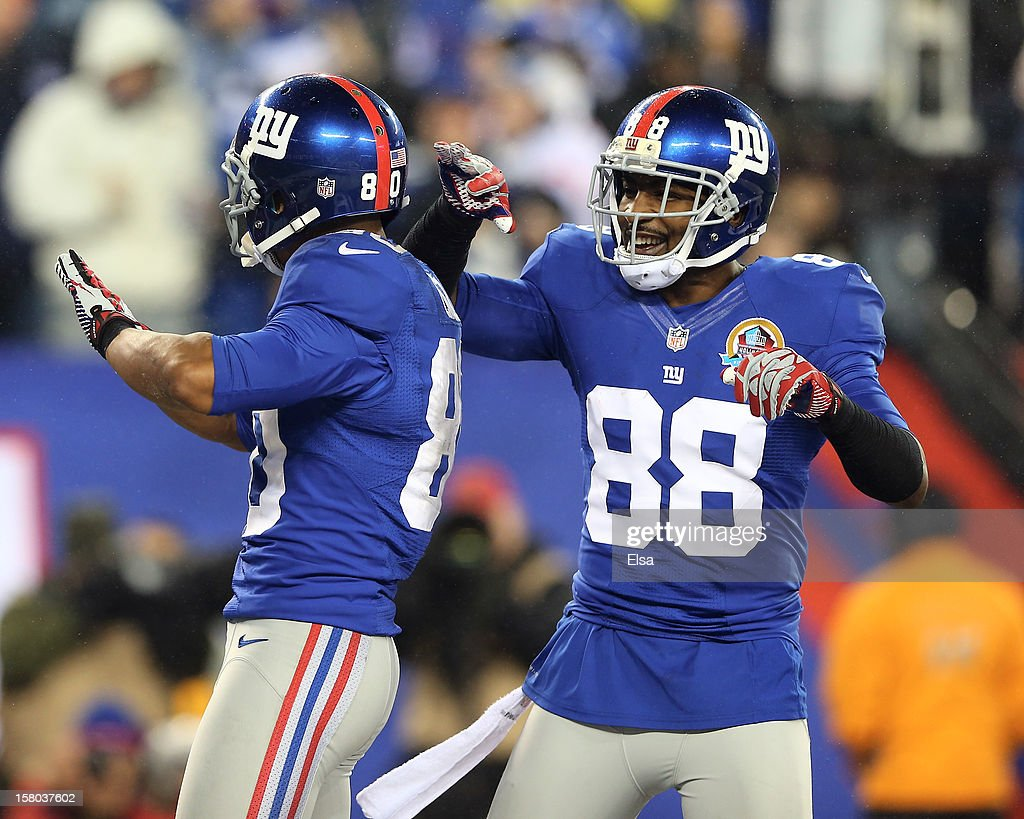 Victor Cruz #80 of the New York Giants celebrates his touchdown with teammate Hakeem Nicks #88 on December 9, 2012 at MetLife Stadium in East Rutherford, New Jersey.
