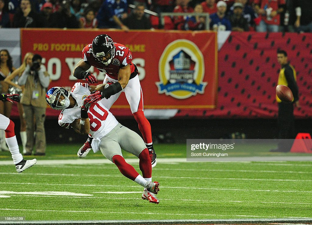 <a gi-track='captionPersonalityLinkClicked' href=/galleries/search?phrase=Victor+Cruz+-+American+Football+Player&family=editorial&specificpeople=8736842 ng-click='$event.stopPropagation()'>Victor Cruz</a> #80 of the New York Giants is hit by <a gi-track='captionPersonalityLinkClicked' href=/galleries/search?phrase=Chris+Hope&family=editorial&specificpeople=210788 ng-click='$event.stopPropagation()'>Chris Hope</a> #24 the Atlanta Falcons at the Georgia Dome on December 16, 2012 in Atlanta, Georgia Hope was called for a personal foul on the play.