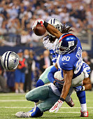 Victor Cruz of the New York Giants makes a touchdown pass reception against Will Allen of the Dallas Cowboys in the second half at ATT Stadium on...