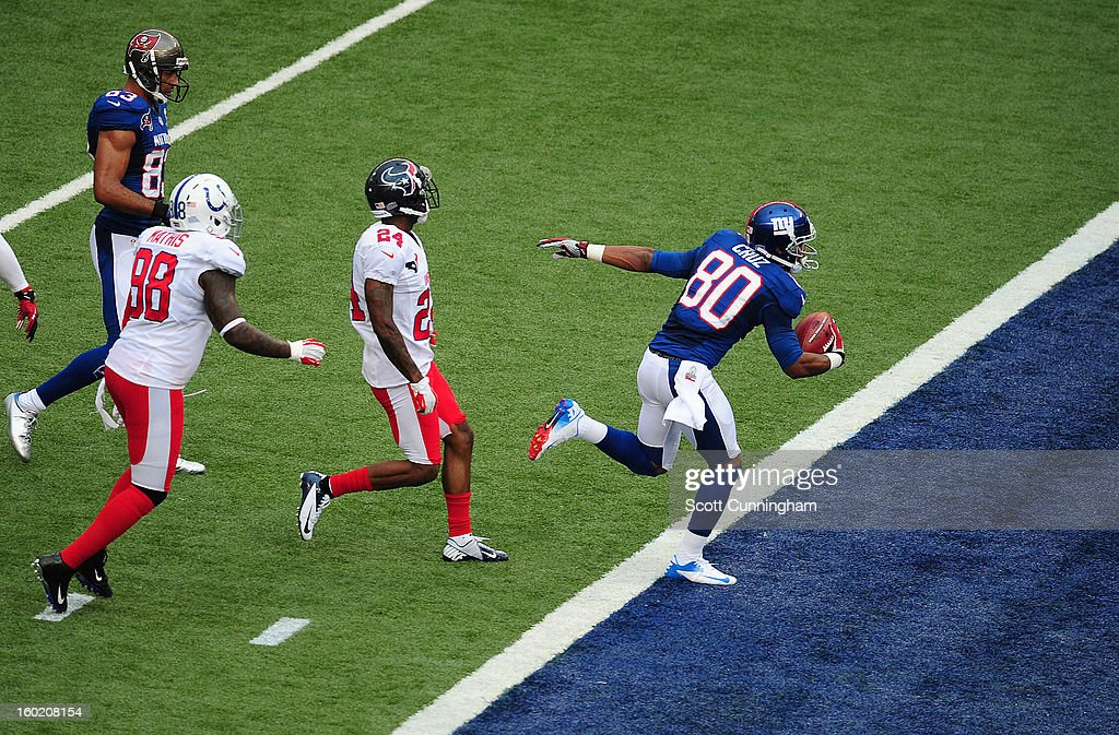 Victor Cruz #80 of the New York Giants scores a second quarter touchdown against the American Football Conference team during the 2013 Pro Bowl at Aloha Stadium on January 27, 2013 in Honolulu, Hawaii