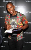 Victor Cruz signs a copy of his Memoir 'Out Of The Blue' at the Launch presented by Hennessy Vs on July 16 2012 in New York United States