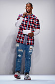 Victor Cruz speaks on the runway at the Kids Rock fashion show during Spring 2016 New York Fashion Week The Shows at The Dock Skylight at Moynihan...
