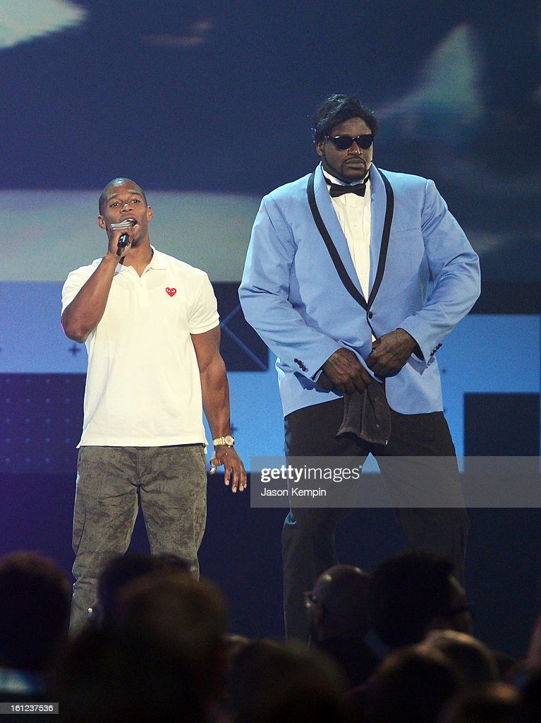 Victor Cruz speaks onstage as host Shaquille O'Neal looks on at the Third Annual Hall of Game Awards hosted by Cartoon Network at Barker Hangar on February 9, 2013 in Santa Monica, California. 23270_003_JK_0747.JPG