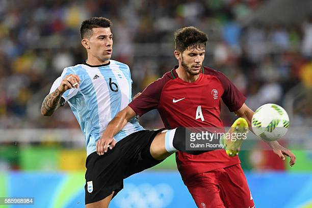 Victor Cuesta of Argentina and Figueiredo Tobias of Portugal compete for the ball during the Men's Group D first round match between Portugal and...