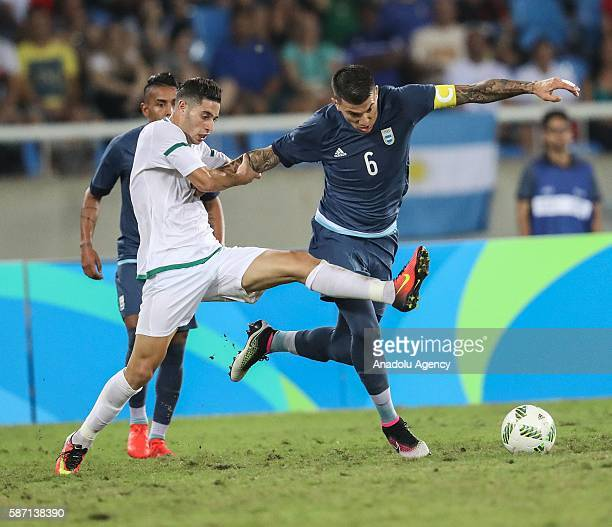 Victor Cuesta of Argentina and Mohammed Benkablia of Algeria vie for the ball during men's football match between Argentina and Algeria at Olympic...