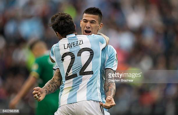 Victor Cuesta of Argentina celebrates with teammate Ezequiel Lavezzi after scoring the third goal of his team during a group D match between...