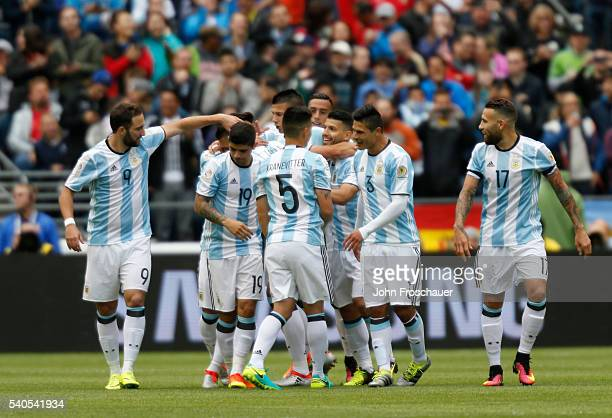 Victor Cuesta of Argentina celebrates with teammates after scoring the third goal of his team during a group D match between Argentina and Bolivia at...