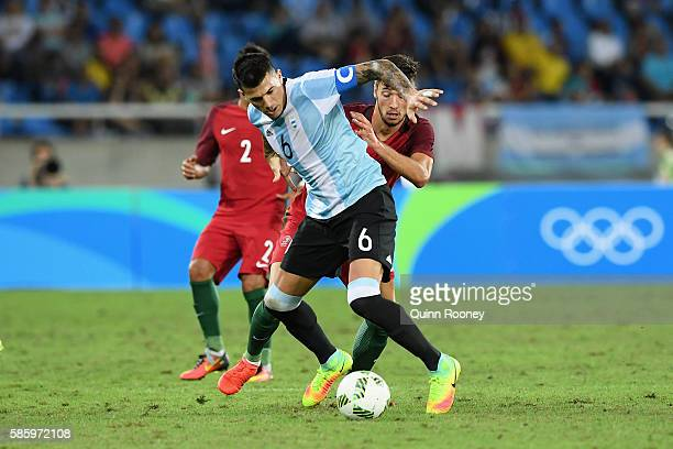 Victor Cuesta of Argentina controls the ball during the Men's Group D first round match between Portugal and Argentina during the Rio 2016 Olympic...