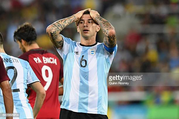 Victor Cuesta of Argentina reacts during the Men's Group D first round match between Portugal and Argentina during the Rio 2016 Olympic Games at the...