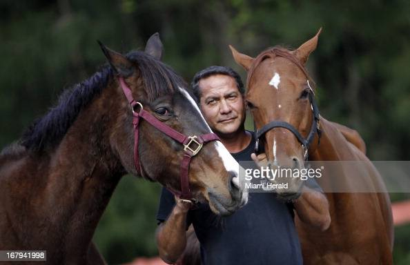 Victor Cutino with rescued horses Haven left and Dreamer February 28 2013 Cutino runs a horse rescue organization called Peaceful Ridge Rescue in...