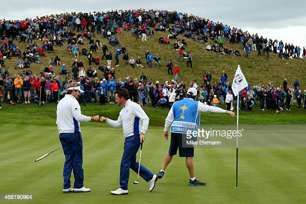 Victor Dubuisson and Graeme McDowell of Europe celebrate on the 3rd green during the Afternoon Foursomes of the 2014 Ryder Cup on the PGA Centenary...