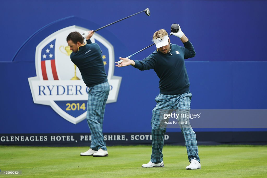 <a gi-track='captionPersonalityLinkClicked' href=/galleries/search?phrase=Victor+Dubuisson&family=editorial&specificpeople=3333395 ng-click='$event.stopPropagation()'>Victor Dubuisson</a> and <a gi-track='captionPersonalityLinkClicked' href=/galleries/search?phrase=Graeme+McDowell+-+Golfer&family=editorial&specificpeople=196520 ng-click='$event.stopPropagation()'>Graeme McDowell</a> of Europe on the first tee during practice ahead of the 2014 Ryder Cup on the PGA Centenary course at the Gleneagles Hotel on September 23, 2014 in Auchterarder, Scotland.