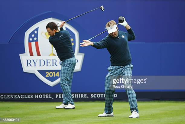 Victor Dubuisson and Graeme McDowell of Europe on the first tee during practice ahead of the 2014 Ryder Cup on the PGA Centenary course at the...