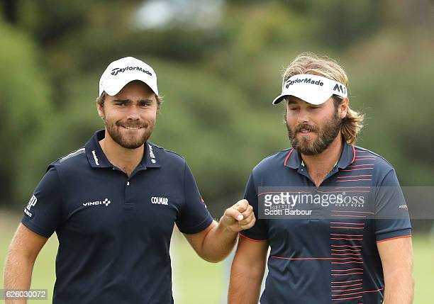 Victor Dubuisson and Romain Langasque of France celebrate as they walk up to the 18th hole during day four of the World Cup of Golf at Kingston Heath...