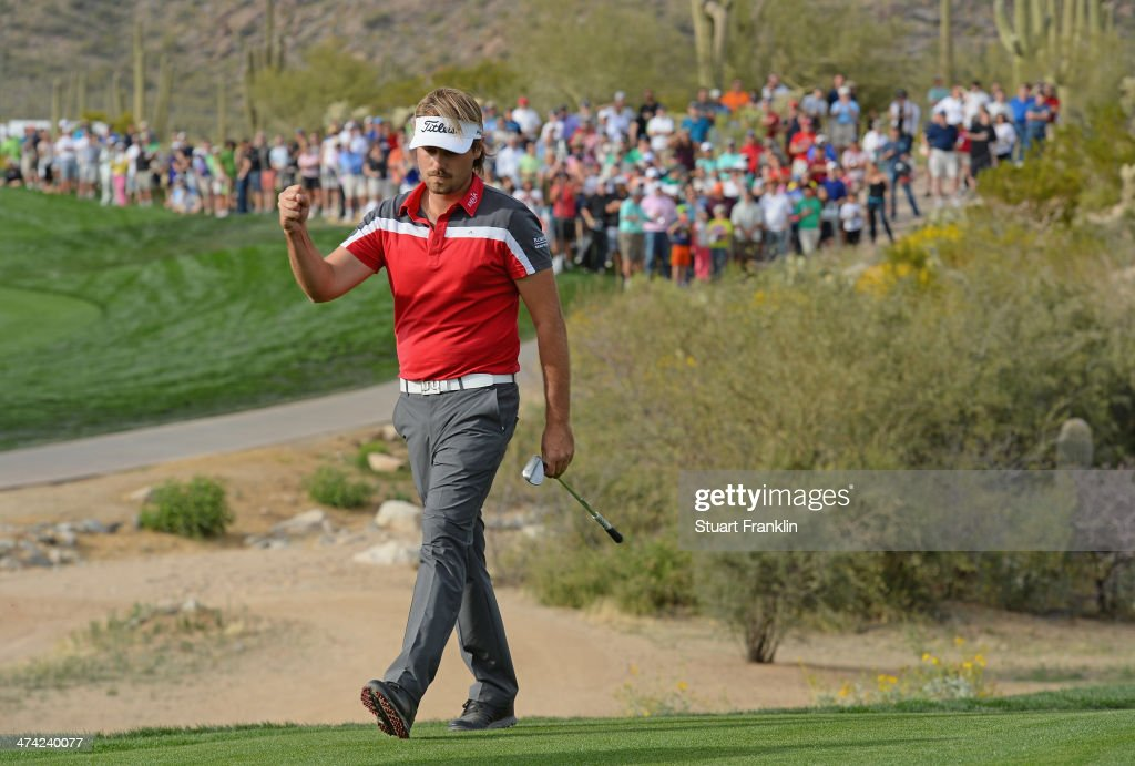 Victor Dubuisson of France celebrates his chip shot on the 18th hole during the quarterfinal round of the World Golf Championships - Accenture Match Play Championship at The Golf Club at Dove Mountain on February 22, 2014 in Marana, Arizona.