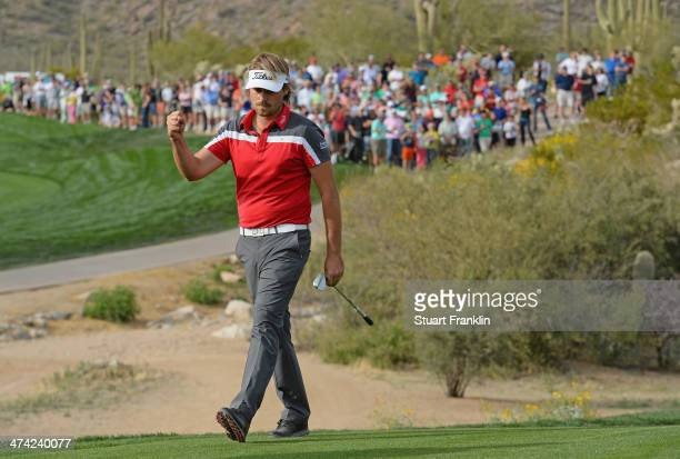 Victor Dubuisson of France celebrates his chip shot on the 18th hole during the quarterfinal round of the World Golf Championships Accenture Match...