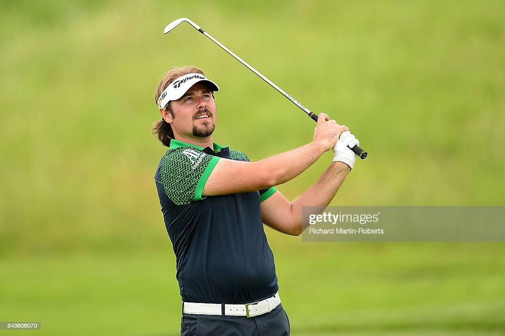 <a gi-track='captionPersonalityLinkClicked' href=/galleries/search?phrase=Victor+Dubuisson&family=editorial&specificpeople=3333395 ng-click='$event.stopPropagation()'>Victor Dubuisson</a> of France hits an approach shot during a pro-am round ahead of the 100th Open de France at Le Golf National on June 29, 2016 in Paris, France.