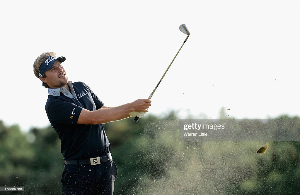 Victor Dubuisson of France hits an approach shot during the second round of the Aberdeen Asset Management Scottish Open at Castle Stuart Golf Links on July 12, 2013 in Inverness, Scotland.