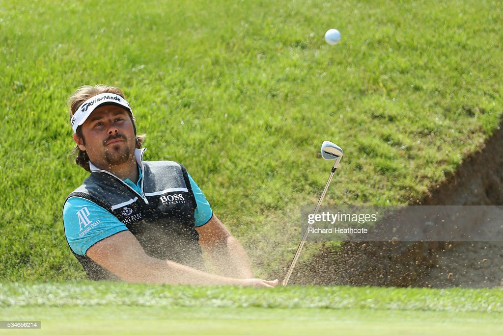 <a gi-track='captionPersonalityLinkClicked' href=/galleries/search?phrase=Victor+Dubuisson&family=editorial&specificpeople=3333395 ng-click='$event.stopPropagation()'>Victor Dubuisson</a> of France hits from a bunker on the 18th hole during day two of the BMW PGA Championship at Wentworth on May 27, 2016 in Virginia Water, England.