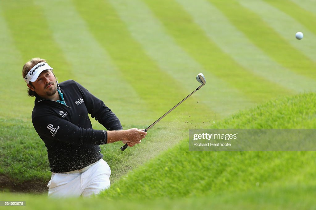 <a gi-track='captionPersonalityLinkClicked' href=/galleries/search?phrase=Victor+Dubuisson&family=editorial&specificpeople=3333395 ng-click='$event.stopPropagation()'>Victor Dubuisson</a> of France hits from a bunker on the 1st hole during day two of the BMW PGA Championship at Wentworth on May 27, 2016 in Virginia Water, England.