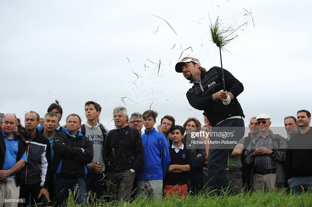 <a gi-track='captionPersonalityLinkClicked' href=/galleries/search?phrase=Victor+Dubuisson&family=editorial&specificpeople=3333395 ng-click='$event.stopPropagation()'>Victor Dubuisson</a> of France hits his 2nd shot from the rough on the 13th hole during the first round of the 100th Open de France at Le Golf National on June 30, 2016 in Paris, France.