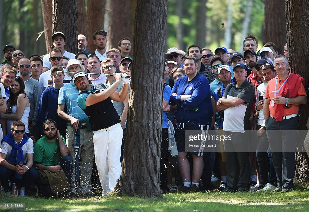 Victor Dubuisson of France hits his 2nd shot on the 13th hole during day two of the BMW PGA Championship at Wentworth on May 27 2016 in Virginia...