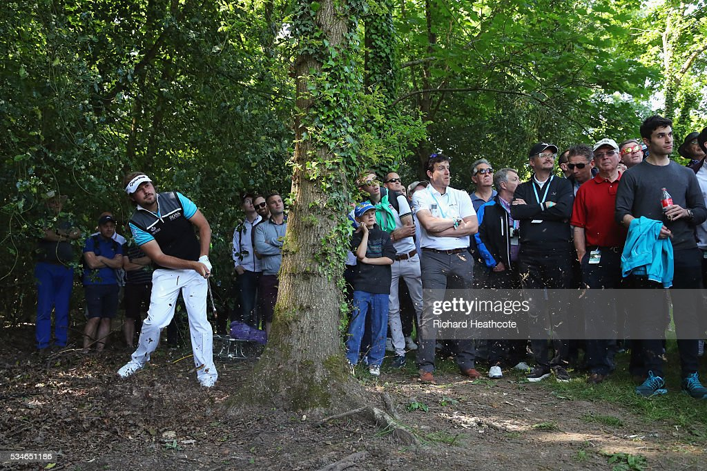 <a gi-track='captionPersonalityLinkClicked' href=/galleries/search?phrase=Victor+Dubuisson&family=editorial&specificpeople=3333395 ng-click='$event.stopPropagation()'>Victor Dubuisson</a> of France hits his 2nd shot on the 17th hole during day two of the BMW PGA Championship at Wentworth on May 27, 2016 in Virginia Water, England.