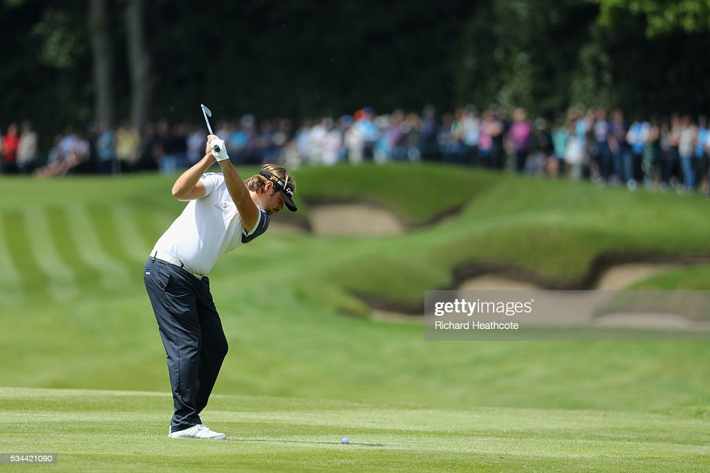 <a gi-track='captionPersonalityLinkClicked' href=/galleries/search?phrase=Victor+Dubuisson&family=editorial&specificpeople=3333395 ng-click='$event.stopPropagation()'>Victor Dubuisson</a> of France hits his 2nd shot on the 1st hole during day one of the BMW PGA Championship at Wentworth on May 26, 2016 in Virginia Water, England.