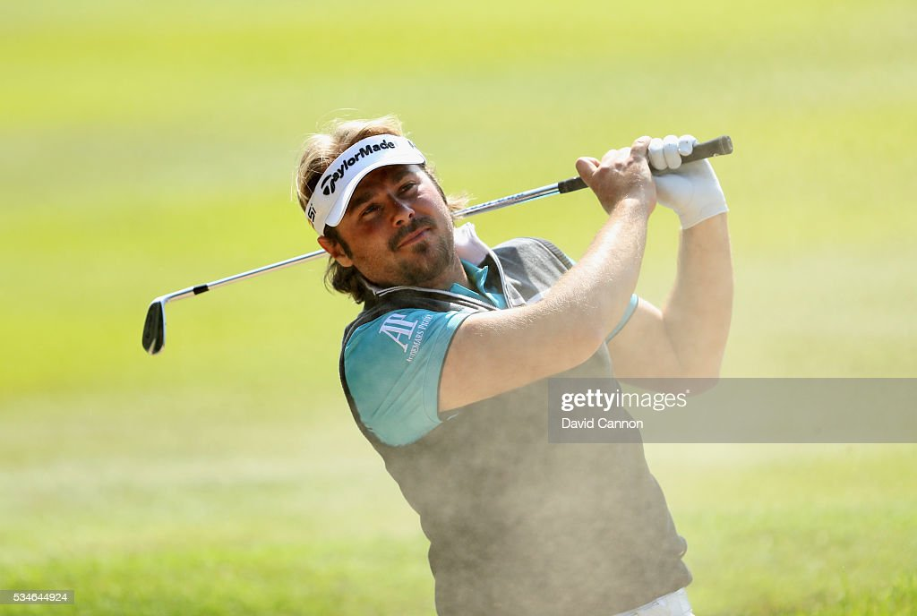 <a gi-track='captionPersonalityLinkClicked' href=/galleries/search?phrase=Victor+Dubuisson&family=editorial&specificpeople=3333395 ng-click='$event.stopPropagation()'>Victor Dubuisson</a> of France hits his 2nd shot on the 9th hole during day two of the BMW PGA Championship at Wentworth on May 27, 2016 in Virginia Water, England.