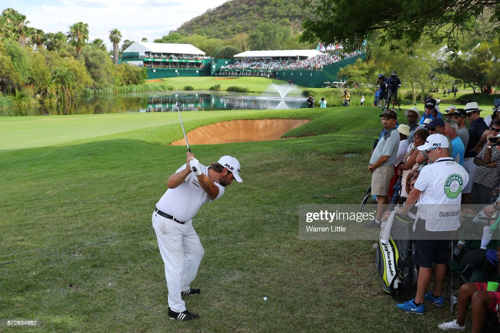Victor Dubuisson of France hits his second shot on the 18th hole during the third round of the Nedbank Golf Challenge at Gary Player CC on November 11, 2017 in Sun City, South Africa.
