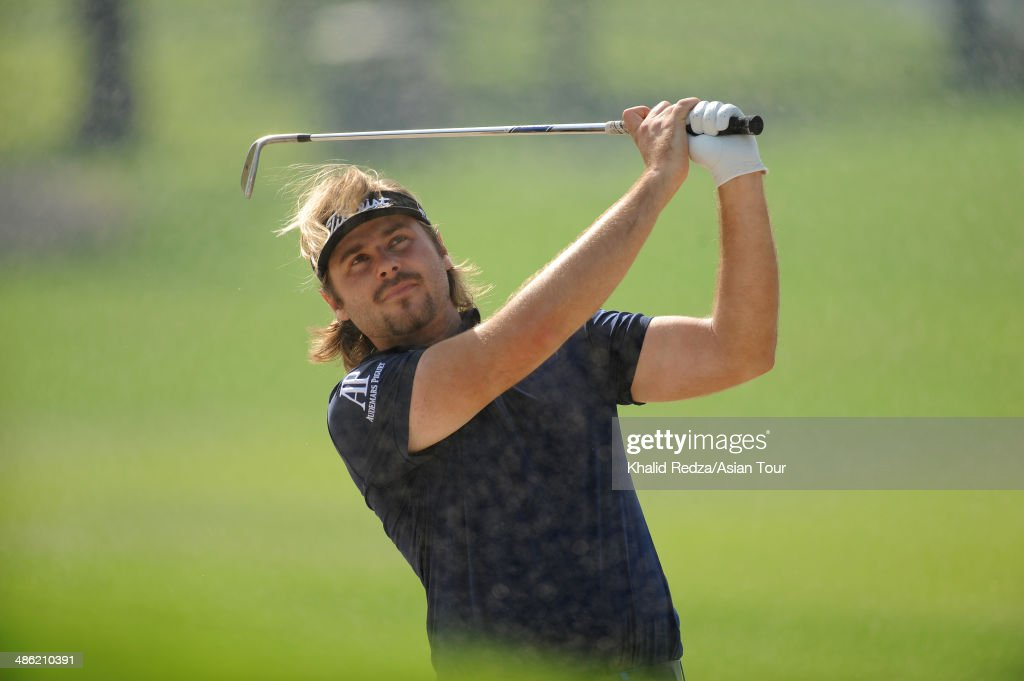<a gi-track='captionPersonalityLinkClicked' href=/galleries/search?phrase=Victor+Dubuisson&family=editorial&specificpeople=3333395 ng-click='$event.stopPropagation()'>Victor Dubuisson</a> of France in action during practice ahead of the CIMB Niaga Indonesian Masters at Royale Jakarta Golf Club on April 22, 2014 in Jakarta, Indonesia.