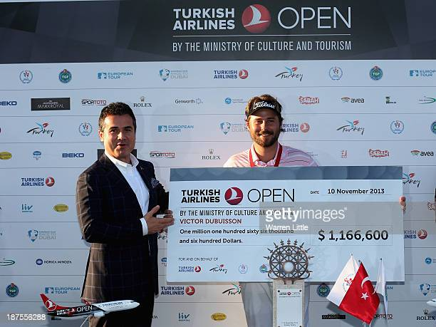 Victor Dubuisson of France is awarded his cheque by Suat Kilic Turkish Minister for Youth Sport after winning the 2013 Turkish Airlines Open on the...
