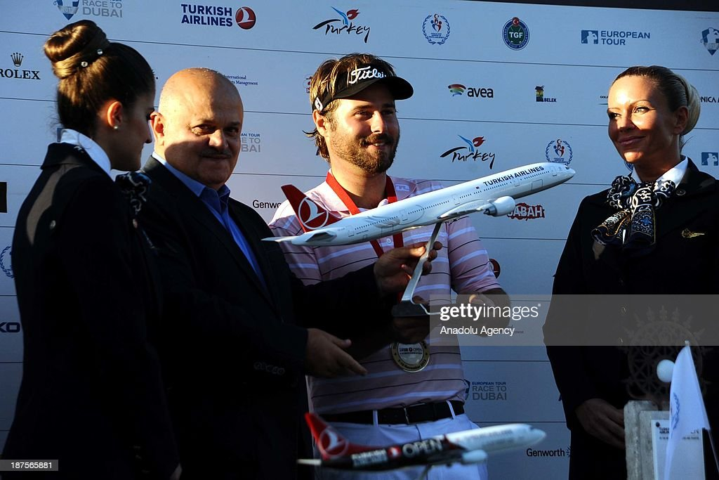Victor Dubuisson of France is awarded the trophy by Hamdi Topcu, Chairman of the Board of Turkish Airlines after winning the 'Turkish Airlines Open Golf Tournament' of PGA European Tour Final Series on November 10, 2013 in Antalya, Turkey.