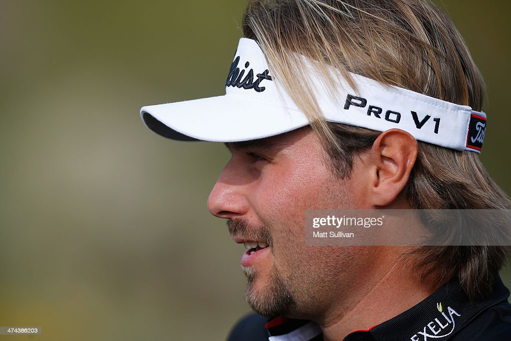 <a gi-track='captionPersonalityLinkClicked' href=/galleries/search?phrase=Victor+Dubuisson&family=editorial&specificpeople=3333395 ng-click='$event.stopPropagation()'>Victor Dubuisson</a> of France looks on during the third round of the World Golf Championships - Accenture Match Play Championship at The Golf Club at Dove Mountain on February 21, 2014 in Marana, Arizona.
