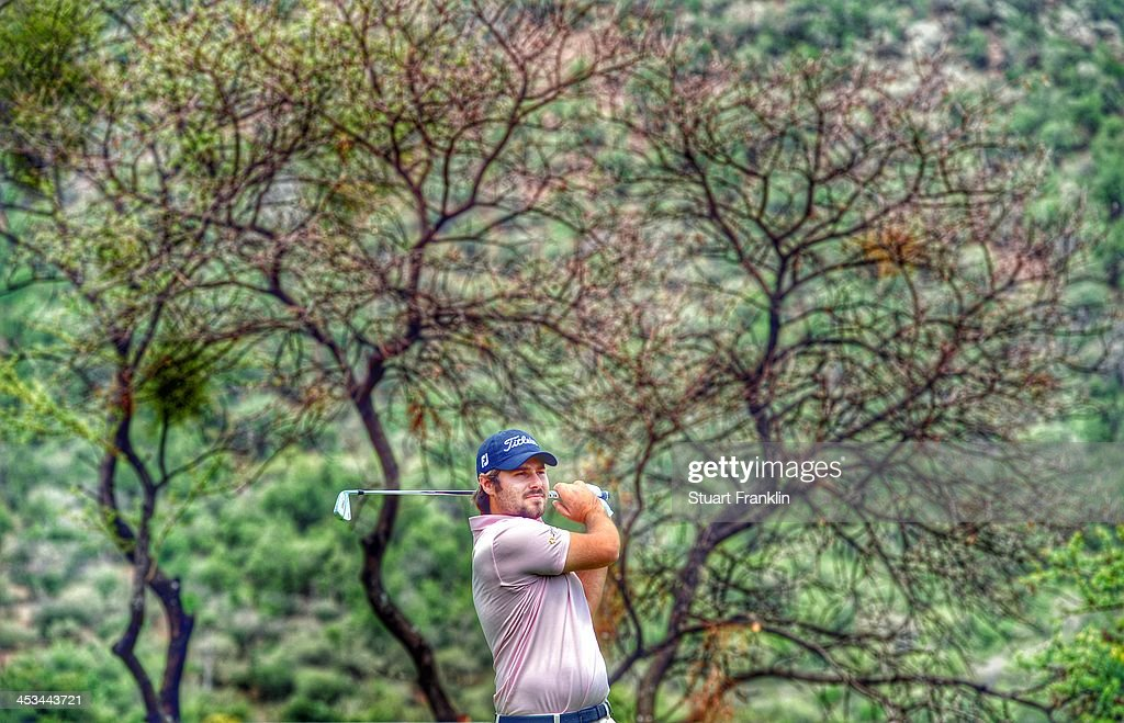 . Victor Dubuisson of France plays a shot during the pro - am prior to the start of the Nedban Golf Challenge at Gary Player CC on December 3, 2013 in Sun City, South Africa.
