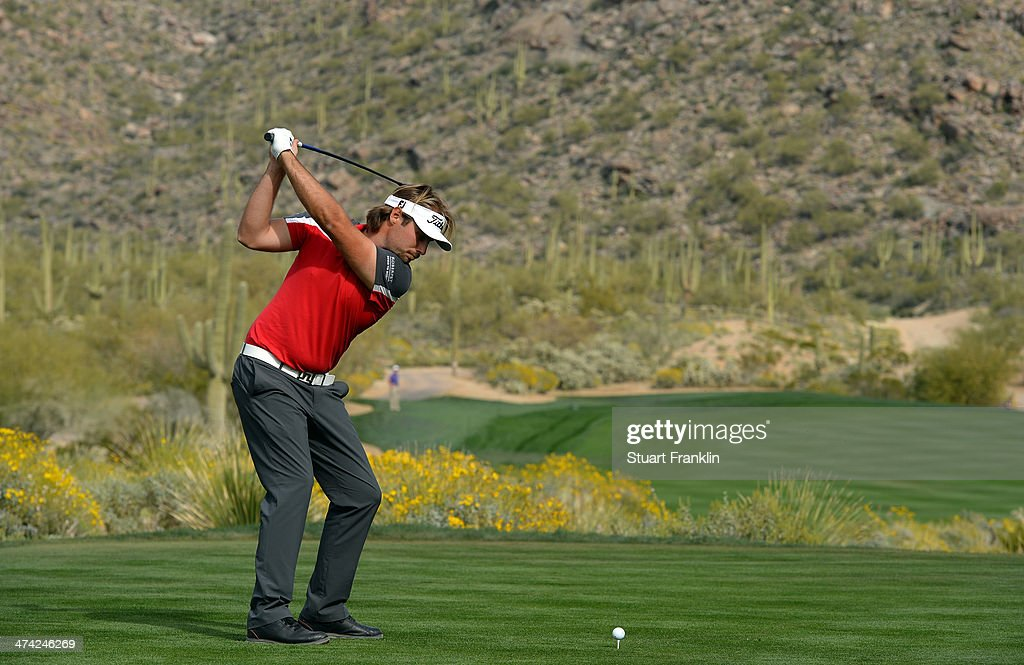 Victor Dubuisson of France plays a shot on the 15th hole during the quarterfinal round of the World Golf Championships - Accenture Match Play Championship at The Golf Club at Dove Mountain on February 22, 2014 in Marana, Arizona.