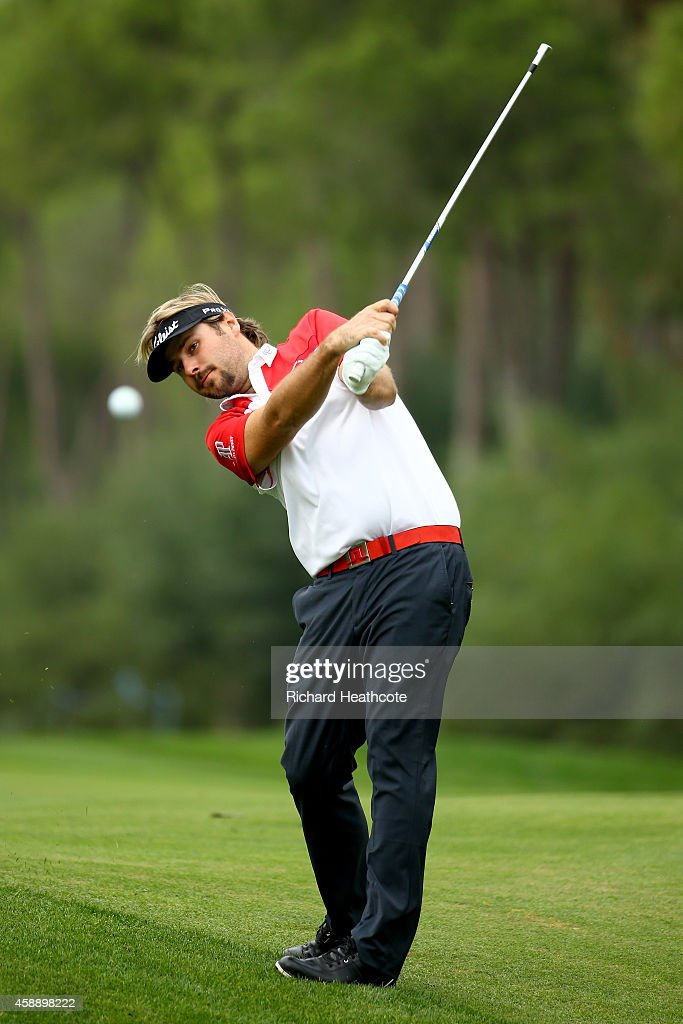 <a gi-track='captionPersonalityLinkClicked' href=/galleries/search?phrase=Victor+Dubuisson&family=editorial&specificpeople=3333395 ng-click='$event.stopPropagation()'>Victor Dubuisson</a> of France plays into the 12th green during the first round of the 2014 Turkish Airlines Open at The Montgomerie Maxx Royal on November 13, 2014 in Antalya, Turkey.