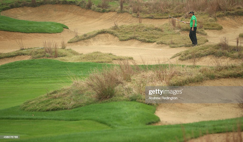 <a gi-track='captionPersonalityLinkClicked' href=/galleries/search?phrase=Victor+Dubuisson&family=editorial&specificpeople=3333395 ng-click='$event.stopPropagation()'>Victor Dubuisson</a> of France prepares to play his third shot on the 14th hole during the first round of the BMW Masters at Lake Malaren Golf Club on October 30, 2014 in Shanghai, China.