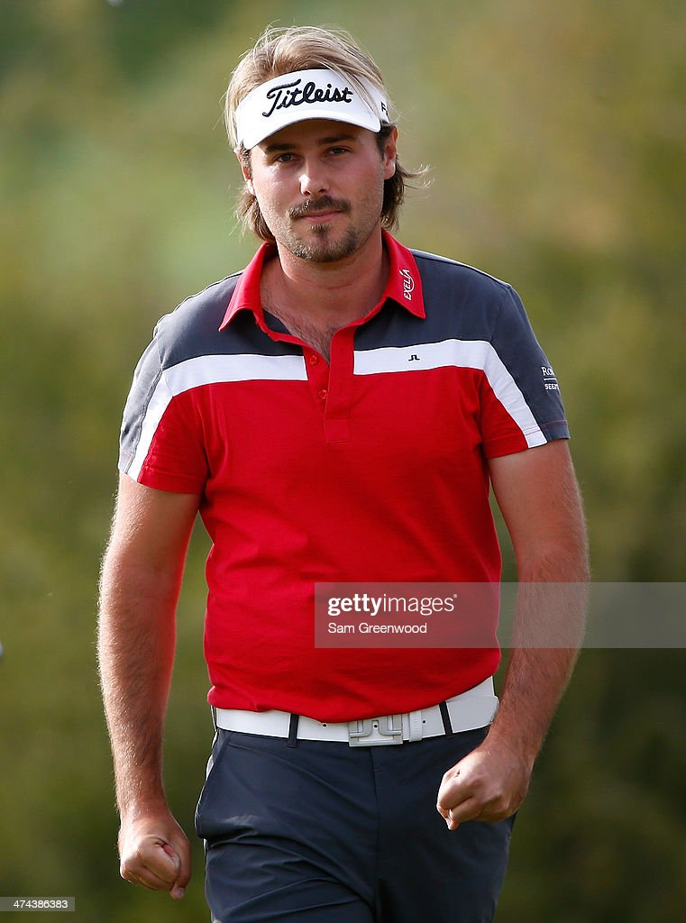 Victor Dubuisson of France reacts following his 1 up victory over Graeme McDowell of Northern Ireland during the quarterfinal round of the World Golf Championships - Accenture Match Play Championship at The Golf Club at Dove Mountain on February 22, 2014 in Marana, Arizona.