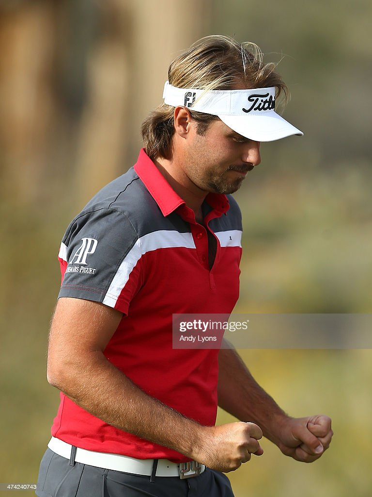 Victor Dubuisson of France reacts following his victory over Graeme McDowell of Northern Ireland (not in photo) during the quarterfinal round of the World Golf Championships - Accenture Match Play Championship at The Golf Club at Dove Mountain on February 22, 2014 in Marana, Arizona.