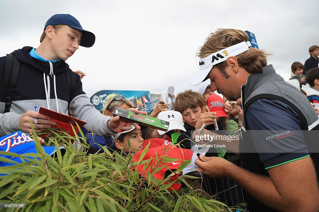 <a gi-track='captionPersonalityLinkClicked' href=/galleries/search?phrase=Victor+Dubuisson&family=editorial&specificpeople=3333395 ng-click='$event.stopPropagation()'>Victor Dubuisson</a> of France signs autographs after his round during day one of the 100th Open de France at Le Golf National on June 30, 2016 in Paris, France.
