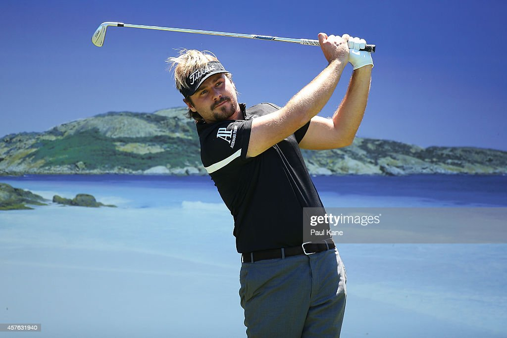 <a gi-track='captionPersonalityLinkClicked' href=/galleries/search?phrase=Victor+Dubuisson&family=editorial&specificpeople=3333395 ng-click='$event.stopPropagation()'>Victor Dubuisson</a> of France tees off on the 15th hole during the 2014 Perth International Pro-Am at Lake Karrinyup Country Club on October 22, 2014 in Perth, Australia.