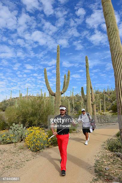 Victor Dubuisson of France walks on the 12th hole during the semifinal round of the World Golf Championships Accenture Match Play Championship at The...